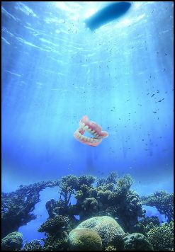 The picture shows a pair of denture being lost in the ocean.